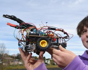 Maia Robertson (13), of Columba College, with her robot named Armadillo. Photo: Gregor Richardson