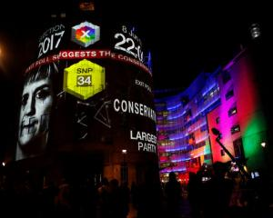 BBC Television centre is illuminated with the results for Britain's general election, as polls are predicting a loss for Theresa May. Photo: Reuters