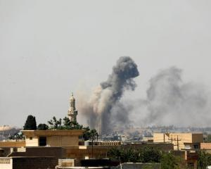 Smoke rises from an air strike by Iraqi forces towards Islamic State militants in the Old City of...