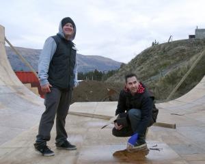 "Wanaka Skate Club members Nick Fellows (left) and Wayne Pretty assemble the ""vert'' skateboard..."