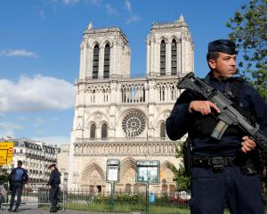 French police and gendarmes stand at the scene of a shooting incident near the Notre Dame Cathedral in Paris. Photo: Reuters