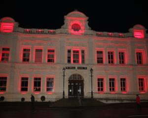 The Oamaru Opera House glows red to mark Anzac Day this year. Photo: Shannon Gillies.