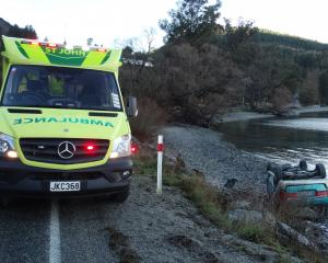 Emergency services attend a one-vehicle crash at Wilson Bay yesterday. Photo: Louise Scott