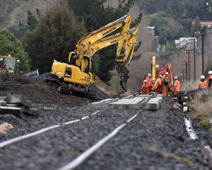 Workers upgrade the railway line near Factory Rd, Mosgiel, yesterday. Photo: Peter McIntosh.