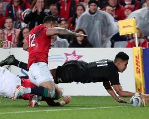 Rieko Ioane of the All Blacks scores a try. Photo: Reuters