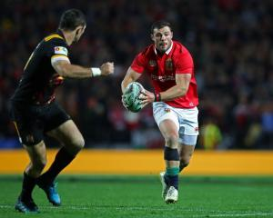 Robbie Henshaw runs the ball for the Lions against the Chiefs. Photo: Getty Images