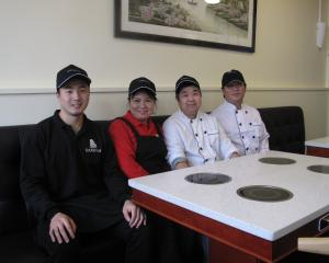 Lydia and Vandee Ung (middle) with their team.