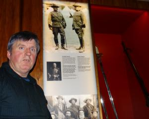 Peter Trevathan next to a display in Toitu Otago Settlers Museum of New Zealand volunteers who fought in the South African War. PHOTO: JOSHUA RIDDIFORD