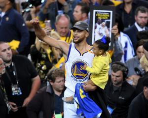Steph Curry celebrates after winning the NBA championship on Tuesday. Photo: Getty Images