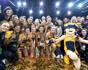 The Sunshine Coast Lightning celebrate their win in the Super Netball final. Photo: Getty Images