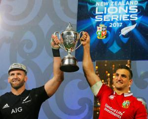 All Black captain Kieran Read (left) and Lions captain Sam Warburton jointly hoist the winner's...