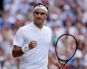 Roger Federer celebrates winning the first set against Mischa Zverev. Photo Reuters