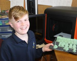 Cromwell College pupil Edward Lawrence (11) whips up parts one of the school's 3-D printers for a...