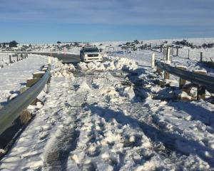 Snow still covers a bridge on Kyeburn River Rd, near Ranfurly, yesterday.  Photo: Fulton Hogan.
