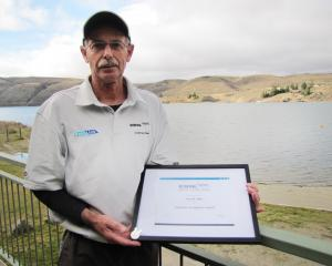 Dunstan Arm Rowing Club life member Russell Mills, of Alexandra, displays the certificate and...