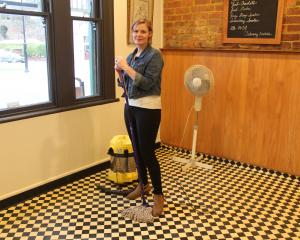 26 Ross Pl Cafe owner Liz McLaughlin begins cleaning after her business was affected by the...