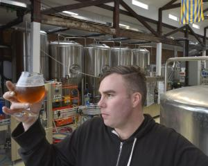 New New New chief brewer Brendan Bransgrove examines a beer before the opening of the...