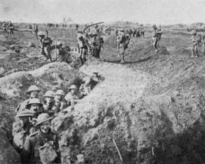 British support troops filing through a trench on the way to join an attack on the Western...