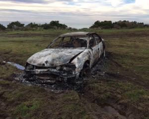 The remains of a white Holden VT Commodore which was found burnt near Wangaloa after it had been...