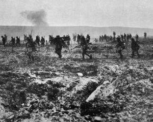 Canadian troops advancing over ``no man's land'' through German barbed wire and under heavy fire...