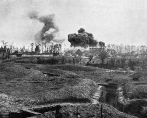 An ammunition dump blown up by the Canadians in a village occupied by the Huns. — Otago Witness,...