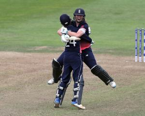 Anya Shrubshole and Jenny Gunn celebrate beating South Africa to make the women's cricket world...