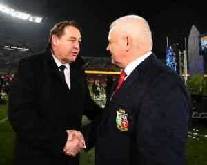 All Black coach Steve Hansen (L) shakes hands with Lions coach Warren Gatland after the match....