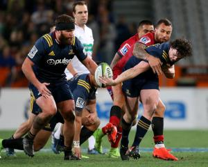 Richard Buckman (R) of the offloads the ball to team mate Liam Coltman of the Highlanders. Photo:...
