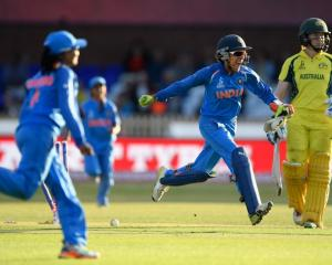 Australia batsman Alex Blackwell is bowled as Sushma Verma celebrates India's victory at The 3aaa...