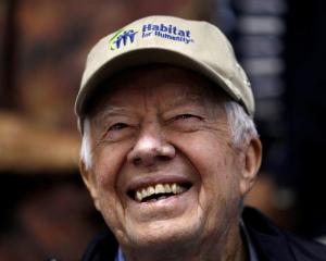By Friday morning, former US President Jimmy Carter was smiling as he returned to the building...