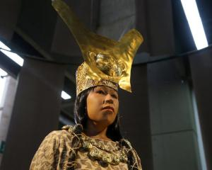 A replica of The Lady of Cao face, a female mummy found at the archaeological site in Peru. Photo...