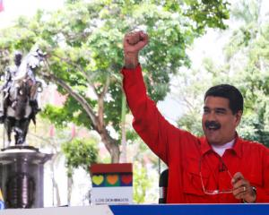 Maduro's unpopular leftist government on Sunday promoted a remixed version of 'Despacito' to...