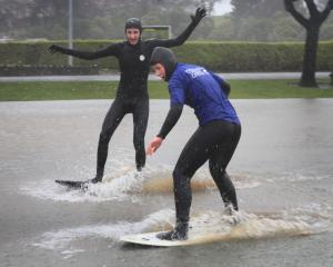 Oamaru siblings Thompson (16) and Aynsley (18)  Martin take advantage of a flooded Awamoa Park...