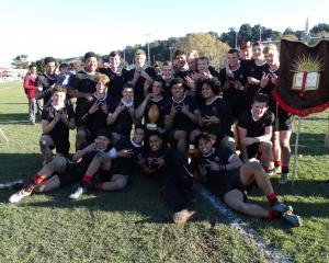 Waitaki Boys' High School's First XV celebrates with the Leo O'Malley Memorial Trophy after...