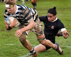 Otago Boys' High School lock Sean Jansen dives for a try during a traditional interschool first...