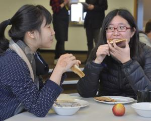 Health science student Yue Tan (left, 20) and Zoology student Xugong Chai (27) start the day the...