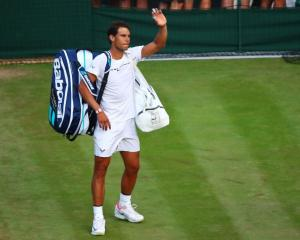 Rafael Nadal waves to the crowd after his loss at Wimbledon. Photo: Getty Images