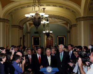 Senate Majority Leader Mitch McConnell, flanked by Senate Republican Leaders, speaks with...