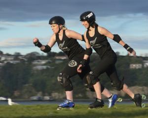 Roller derby skaters Charmaine Reveley (left) and Mel Huddy race along Portsmouth Dr in Dunedin...