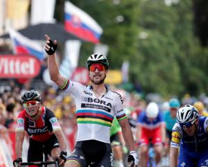 Bora-Hansgrohe rider Peter Sagan of Slovakia celebrates winning the third stage of the Tour de...