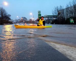 Daniel de Garnham, of Timaru, makes use of his kayak on State Highway 1, near BP, Showgrounds,...