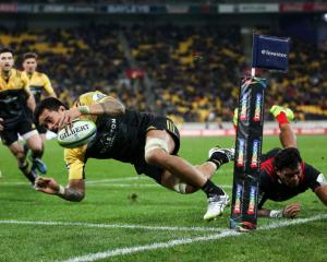 Vaea Fifita of the Hurricanes scores a try. Photo: Getty
