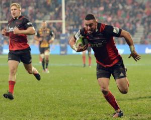Bryn Hall of the Crusaders runs through to score a try. Photo: Getty