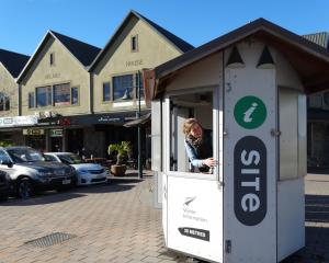 Wanaka i-Site manager Jaimee McGrath in the former Ardmore St i-Site kiosk which is for sale....
