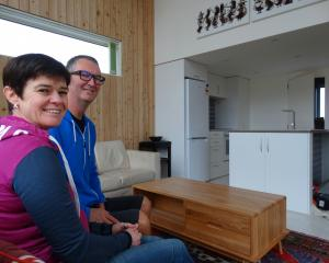 Wanaka couple Will and Jennie Croxford in their nearly completed tiny home. The  house consists...