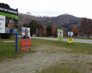 Billboards advertise candidates in the Wanaka by-election. Photo: Tim Miller.