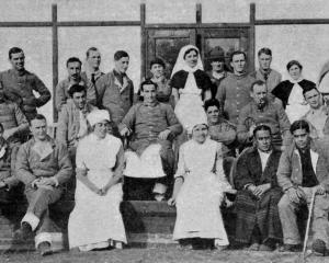 A group of New Zealanders in Walton-on-Thames Hospital, England. Private C. Somerville is seated...