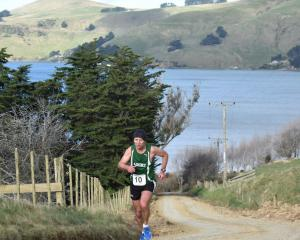 Brent Halley strides up Weir Rd from Papanui Inlet on the final leg of the Peninsula Relay on...