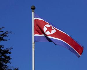 A North Korean flag flies on a mast at the Permanent Mission of North Korea in Geneva,...