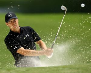 Jordan Spieth plays from a bunker on the 15th hole during a practice round for the 2017 PGA...